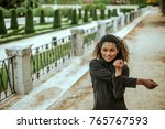 fit woman stretching her arms... | Shutterstock . vector #765767593