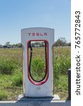 Small photo of FLATONIA, TEXAS, USA: Tesla Supercharger near Amigo's Travel Center & gas station from Houston to San Antonio.