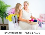 grandmother knitting with...   Shutterstock . vector #765817177