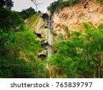 deep forest waterfall in... | Shutterstock . vector #765839797