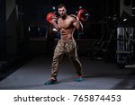 brutal strong bodybuilder... | Shutterstock . vector #765874453
