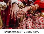 tender hands of an indian bride ... | Shutterstock . vector #765894397