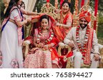 women put a cloth on indian... | Shutterstock . vector #765894427