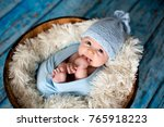little baby boy with knitted... | Shutterstock . vector #765918223