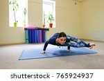 young woman doing downward... | Shutterstock . vector #765924937