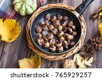 roasted chestnuts in a pan top... | Shutterstock . vector #765929257