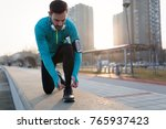 runner trying running shoes... | Shutterstock . vector #765937423
