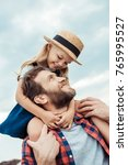 little girl hugging happy... | Shutterstock . vector #765995527