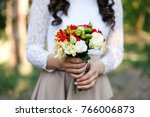 the girl holds a bouquet of... | Shutterstock . vector #766006873
