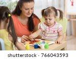 children painting in preschool. ... | Shutterstock . vector #766043593