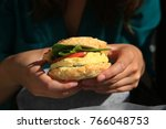 woman holds an egg  tomato ... | Shutterstock . vector #766048753