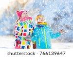 kids playing in snow. children... | Shutterstock . vector #766139647
