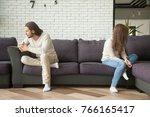 unhappy sad couple sitting...   Shutterstock . vector #766165417