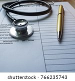 the stethoscope and pen put on... | Shutterstock . vector #766235743