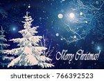 christmas tree at night snowing   Shutterstock . vector #766392523