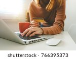 business man hands using laptop ... | Shutterstock . vector #766395373