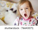 little yawning toddler girl in... | Shutterstock . vector #76643371