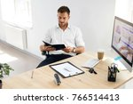 young business man working on... | Shutterstock . vector #766514413