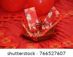 "Small photo of Chinese traditional wedding ornaments with mascots, Chinese characters on the red packet mean ""Perfect Conjugal Bliss"", and ""Double Happiness""."