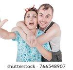 funny retro couple taking photo ...   Shutterstock . vector #766548907