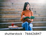 asian college student reading... | Shutterstock . vector #766626847