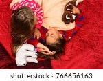 kids in pajamas touch hair on... | Shutterstock . vector #766656163