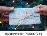 giving a christmas blue gift... | Shutterstock . vector #766664263