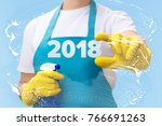 cleaner shows the numbers 2018 .... | Shutterstock . vector #766691263