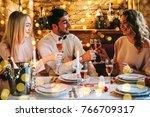 friends celebrating christmas... | Shutterstock . vector #766709317