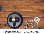 stethoscope with judge gavel.... | Shutterstock . vector #766759783