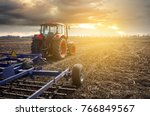 tractor working on the farm  a... | Shutterstock . vector #766849567