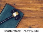gavel and law book on a wooden