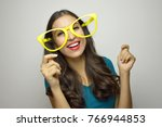 funny girl with yellow big... | Shutterstock . vector #766944853