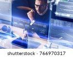 businessman analysing the data... | Shutterstock . vector #766970317