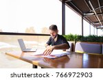 placeman sorting papers on desk ... | Shutterstock . vector #766972903