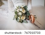 bride in white dress sits on... | Shutterstock . vector #767010733