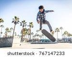 cool skateboarder outdoors  ... | Shutterstock . vector #767147233