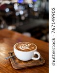 cup of coffee latte on wood bar ... | Shutterstock . vector #767149903