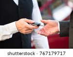 close up of valet's hand giving ... | Shutterstock . vector #767179717