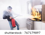 young man using red fire... | Shutterstock . vector #767179897