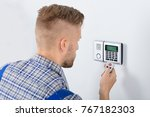 close up of repairman using... | Shutterstock . vector #767182303