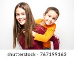 joyful brother and sister... | Shutterstock . vector #767199163