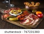 a delicious charcuterie... | Shutterstock . vector #767231383