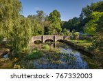 stone bridge in the cotswolds... | Shutterstock . vector #767332003