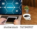 webinar hand on table use e... | Shutterstock . vector #767340907