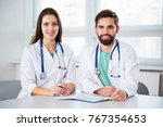 group of doctors in clinic at... | Shutterstock . vector #767354653