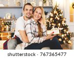 sweet couple opening christmas... | Shutterstock . vector #767365477