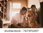 female potter mentoring a woman ... | Shutterstock . vector #767391007
