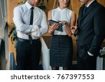 the employees of the firm are... | Shutterstock . vector #767397553