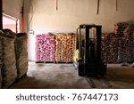 a forklift sits in an informal...   Shutterstock . vector #767447173